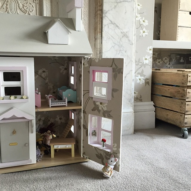 Another peek at a nearly completed girl's room: matching wallpaper inside the dollshouse! #kidsinteriors #kidsinteriordesign