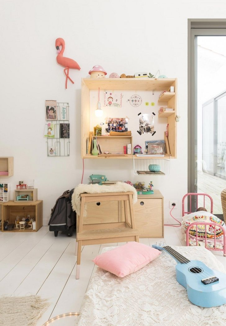 white boho kids room room with pine and plywood furniture