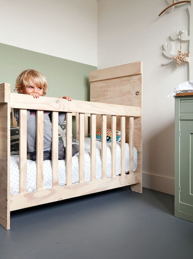 gender neutral nursery with green two tone wall
