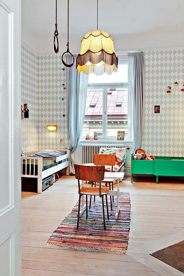green kids room with harlequin wallpaper